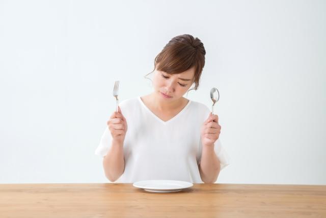 食事に困る女性